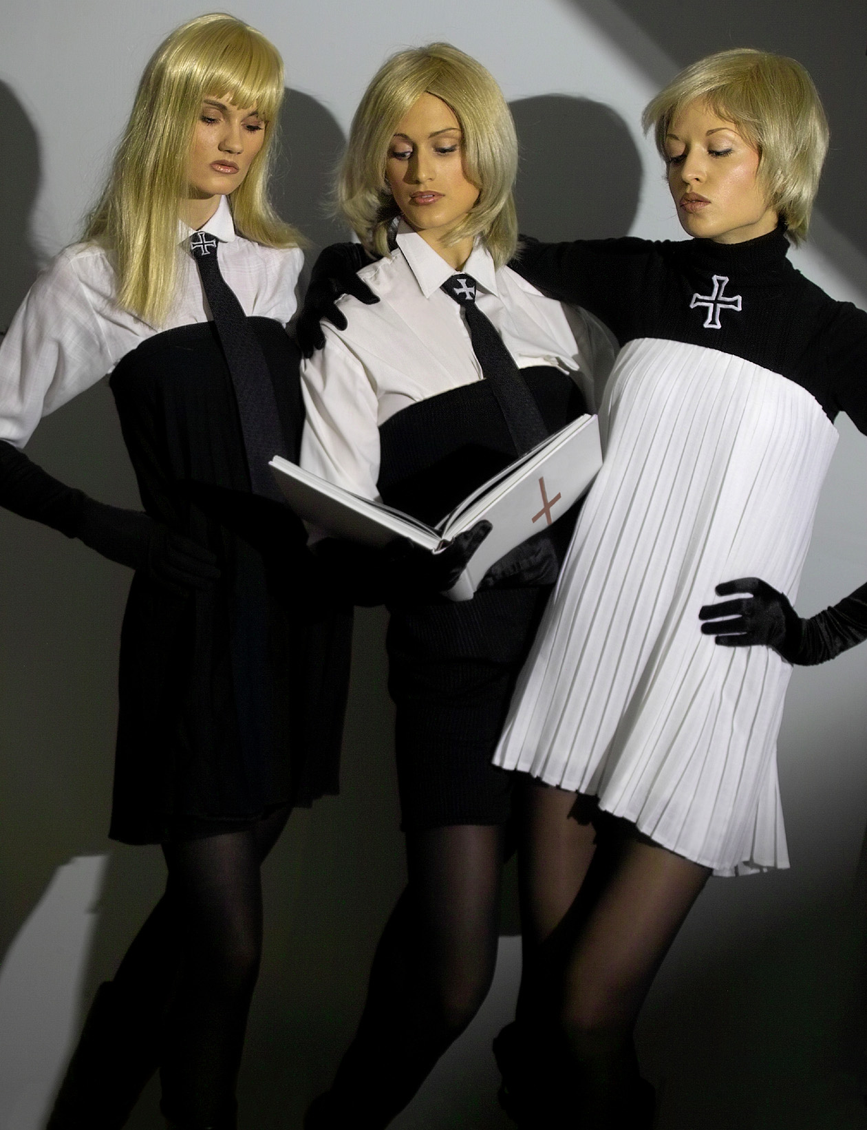 The fashion model`s Franziska Scheffer, Juliana Schmidt and Vera Gafron in avant-garde dresses and blouses of luxury cotton with cross motives on neck-tie`s and sweater from fashion designer Torsten Amft`s fall / winter 2008 - 2009 trend collection for Berlin Fashion Week - photographer Mark van Straaten