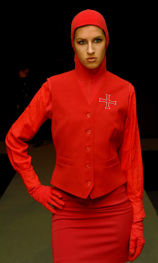 Red avant-garde outfit in finest cashmere wool from fashion designer Torsten Amft`s fall / winter 2008 - 2009 trend collection at Berlin Fashion Week - fashion runway model Lisa - photographer M. Wittig